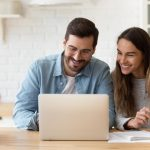 Couple Looking at Laptop - Finance Jeanie